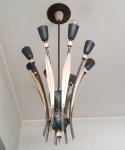 Lustre para 8 lâmpadas,  anos 50/60 de metal patinado. Medida 80 x 40 cm.