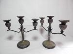 Par de candelabros para 3 velas cada em metal espessurado à prata, base e porta-velas em gomados. Marcados no fundo Bristol. 25 x 27 x 11cm.