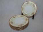 NORITAKE - Seis pratos rasos em porcelana japonesa, borda com esmaltagem bege, medalhões de buquê de flores circundado por volutas e acantos interligados por guirlandas, friso grená. Marcado no fundo. Diam. 26,5cm.