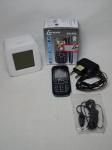 Duas peças: a) Telefone celular Lenoxx modelo CX-903. Embalagem original. Não testado e sem garantias. b) Relógio de mesa digital, caixa em plástico branco. Marcado Capello. Não testado e sem garantias. 9 x 8,5 x 6cm.