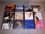 Doze CD's de diversos artistas e estilos.