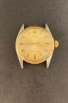 Relógio Rolex Oyster Perpetual ouro e aço, sem pulseira, numeração 1299042, medindo 3cm de diâmetro