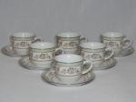 SCHIMIDT - Seis xícaras e pires para chá em porcelana nacional branca. Decoração em ver dourado com volutas e folhagens. Modelo Voyage Barroco. 7 x 14cm.