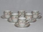 SCHIMIDT - Seis xícaras e pires para café em porcelana nacional branca. Decoração em ver dourado com volutas e folhagens. Modelo Voyage Barroco. 6 x 10cm.