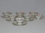 KPM - Sete xícaras e pires para chá em porcelana polonesa branca, borda filetada a ouro, detalhes de acantos moldados na pasta, decoração de arranjos florais policromados. 7 x 15cm.