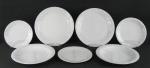 Quarenta e oito pratos em porcelana, com marca da manufatura no verso, decorados nas abas com cachos de uvas e parreiras, em relevo, sendo 12 rasos, 12 fundos 12 para sobremesa e 12 para pão. Diam. maior 25,5cm.