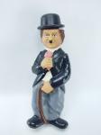Boneco Charlie Chaplin de Vinil do ano de 1985, Manufatura Bubbles, Conservado, Medindo 19 cm de altura, Obs: Quando o aperta ele apita e seu chapéu sobe, conforme fotos