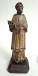 IMAGEM SACRA- Antigo imaginário representando SÃO RAIMUNDO NONATO, peça executada em madeira policromada e olhos de vidro, med. 27 centímetros.