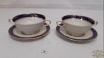 2 Xícaras Consume Porcelana Bavaria  alema  bordas azuis e Friso Dourado .  Medida: pires 16cm diâmetro , xicara 5 cm de altura e 12 cm diâmetro.O pores apresenta pequeno bicado