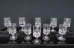 Conjunto de dez cálices para licor  em fino cristal  translúcido , base redonda, haste facetada, bojo lapidação dita dedão. Med. 8,5 cm alt.