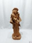 """Escultura, imagem de Santo Antonio em terracota, assinada """"assinatura ilegível"""". Medindo 47cm de altura."""