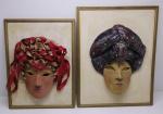 PANDAN - Lote de 2 quadros com máscaras em argila, masculina e feminina com aplicações diversas, emolduradas, assinatura não identificadas e datadas de 1999. Med. Maior 31 cm  e menor 27 cm, molduras 45x35 cm e 40x30 cm.