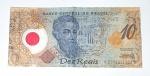 """Cédula de 10 Reais, produzida em plástico """" Pedro A. Cabral """"."""