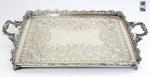 MICHEL KHOURY - Brasil, Séc.XX. - Magnífica bandeja em prata de lei, contraste MK 800 e PB. Galeria e fundo delicadamente cinzelado com motivos florais. Alças com influência Art Noveau. Pés em garra. Mede: 52 cm x 31 x 08 cm. Peso: 1845 gramas