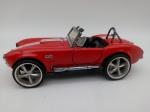 Colecionismo. Miniaturas. Automóvel Shelby Cobra 427 S/C escala 1/34. Mede 13,5cm de comprimento.