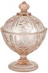 ANOS 40 - Belíssima Compoteira, em vidro prensado, em rara tonalidade salmão, decoração em relevos no padrão fitomórfico, pega em pinha. Dimensões: 18 cm X 12,5 cm (Alt./Diâm.) ccc