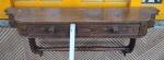 Interessante console de parede com 2(duas) gavetas, parte frontal entalhado, suporte de sustentação arqueado  com travessa com entalhes no formato de anéis, e  demanda limpeza de cera. Med. 22cm x 79cm. Não pode ser enviado pelo correio.