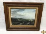 Quadro de óleo sobre tela retratando paisagem assinado A. Ruiz, com moldura em madeira. Medindo a moldura 56cm x 46cm e a tela 38,5cm x 28,5cm.
