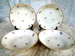 WARWICK - made in USA - Quatro Tigelinhas em porcelana esmaltada na cor bege e vitrificada com flores delicadas na ornamentação e frisos em ouro nas bordas. Diâmetro 13,5 cm e altura 3,5 cm.